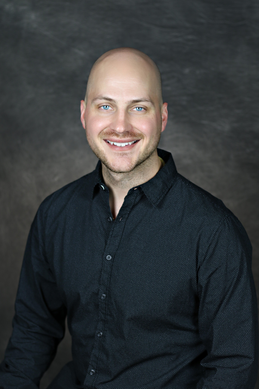 Dr. Adrian Barker